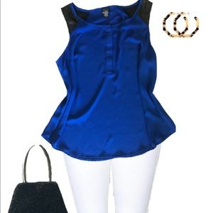 Royal blue sleeveless blouse with black leather.